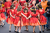 Girls dancing at the parade for the Madeira Flower Festival, Funchal, Madeira, Portugal