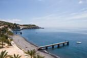 Beach, pier and Airport runway, Santa Cruz, Madeira, Portugal