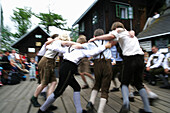 Boys in traditional costumes dancing, Styria, Austria