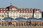 Horseback Ride On The Beach Across From The Casino, Lais De Mer Equestrian Center And Riding School, Deauville, Calvados (14), Normandy, France