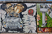 Languorous Kiss Between Honecker And Breshnev (Dimitri Vrubel) With The Trabant Smashing The Wall, East Side Gallery (Mauer Galerie), The Open-Air Gallery Of The Muhlenstrasse, With Works By 118 Artists From 21 Countries, Makes Up The Longest Preserved Se
