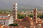 Saint Martin Cathedral, Duomo San Martino And San Giovanni Church, Seen From The Roofs Of Lucca, At The Bottom Of The Garfagna Valley And The Foothills Of The Apuane Alps, Tuscany, Italy