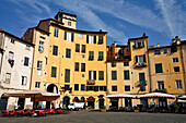 Rounded Houses On The Piazza Del Mercato Or Dell'Anfiteatro, Contours Of The Old Roman Amphitheater, Town Of Lucca, Tuscany, Italy