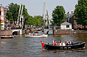 Boat With A Flag With Three Crosses, Emblem Of The City Of Amsterdam, Keizersgracht, Netherlands, Holland