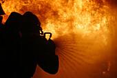 Firemen Undergoing Training In Fire Fighting, Simulation Of An Industrial Fire, Ifopse, Nivillac, Morbihan (56), France