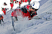 Climbing An Ice Cascade With Crampons And Ice Axes. Survival Training For Helicopter Pilots Of The Civil Emergency Services Supervised By The Fire Department, La Meije Lagrave, Hautes-Alpes (05), France