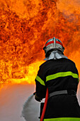 Extinction Of A Fire With A Foam Hose. Training Of The Firefighters Of The Sdis38 In Hydrocarbon Fires, Gesip (Studies Group For Safety In The Petrol And Chemical Industries) Of Roussillon, Isere (38), France