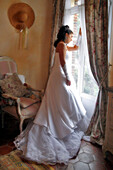 Bride In A White Gown Next To A Window, Preparations For The Wedding, France