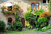House with frescos and floral decoration, Barna, Monti Lariani, Lake Como, Lombardy, Italy