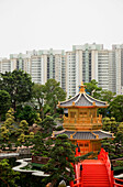 Garden of the Chi Lin nunnery with skyscrapers in the background, Kowloon, Hong Kong, China
