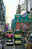 Double decker tram and neon signs, Hong Kong, China