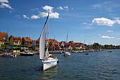 Marina of Mikolajki (Nikolaiken) on Lake Mikolajskie, Mazurskie Pojezierze, Masuren, East Prussia, Poland, Europe