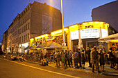 Young people in front of a night club, Leipzig, Saxony, Germany