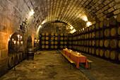 Table setting in the cellar of Bodegues Santa Catarina Winery, near Andratx, Mallorca, Balearic Islands, Spain, Europe