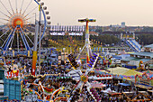 People at the Oktoberfest in the evening, Munich, Bavaria, Germany, Europe