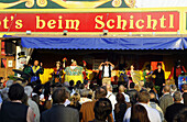 People in front of the show booth at Schichtl, Oktoberfest, Munich, Bavaria, Germany, Europe