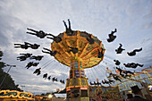 Chain swing ride in the evening, Schuetzenfest Hanover, Lower Saxony, Germany