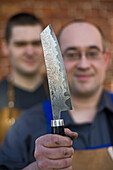 Lars Scheidler, bladesmith, with a Nesmuk knife, handcrafted most expensive knives, Wunstorf, region Hanover, Lower Saxony, northern Germany