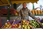 woman selling fruit and vegetables,market, Springe, Hanover region, Lower Saxony, northern Germany