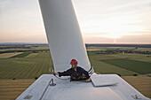 Maintenance worker on wind power station near Sehnde, Lower Saxonay, Germany