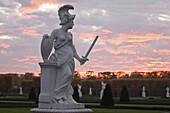 Minerva sculpture in dusk, Great Garden, Herrenhausen Gardens, Hanover, Lower Saxony, Germany