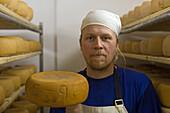 Olaf,  cheese production, Adolphshof near Lehrte, Hannover, Lower Saxony, Germany