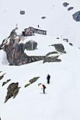 Two back-country skiers near Albert Heim mountain lodge, Urner Alps, Canton of Uri, Switzerland