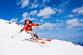 Woman downhill skiing, Wildhorn, Bernese Alps, Canton of Valais, Switzerland