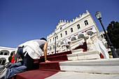 Pilgrim on the stairs of pilgrimage basilica Panagia Evangelistria, Tinos-town, island of Tinos, the Cyclades, Greece, Europe