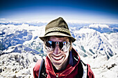 Man with sunglasses smiling at camera, Watzmann, Berchtesgaden Alps, Berchtesgaden, Bavaria, Germany