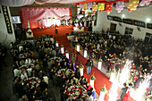 People at a festival room at a traditional chinese wedding, Jinfeng, Changle, Fujian province, China, Asia
