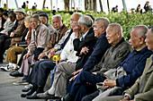 Old men sitting in a park, Lundu district, Xiamen, Fujian province, China, Asia