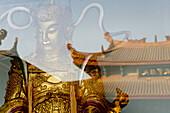 Statue of Weituo and reflection of the Puguang temple, Xiamen, Fujian, China, Asia
