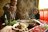 Chinese couple eating at a restaurant, Peking, Beijing, China, Asia