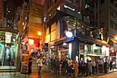 People on the street in front of a bar, Lan Kwai Fong, Hongkong, China, Asia