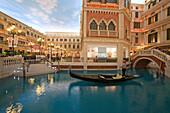 Shops and canal with gondola at Venetian Casino Resort, Macao, Taipa, China, Asia