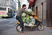 Man transporting vegetables on a scooter, Fuzhou Road, Shanghai, China, Asia