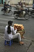 French bread vendor on the roadside during Tet festival, Saigon, Ho Chi Minh City, Vietnam, Asia