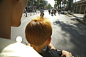 Father and son driving moped, Saigon, Ho Ch minh City, Vietnam, Asia