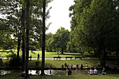 People relaxing in English Garden, Munich, Bavaria, Germany, Europe