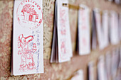 Slips of paper with wishes for the future at a board, Confucius Temple, Tainan, Republic of China, Taiwan, Asia