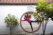 German tourist inside the moon gate of a temple, Tainan, Republic of China, Taiwan, Asia