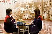 Two women at Taiwanese noodle restaurant Chi Kin Dandanmian, Tainan, Republic of China, Taiwan, Asia