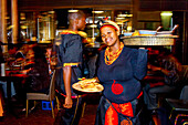 African waitress in an African restaurant, Cape Town, Western Cape, South Africa, Africa