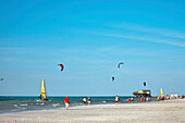 Kitesurfing near beach, Sankt Peter-Ording, Schleswig-Holstein, Germany