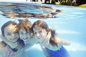 Kids having fun in the family pool,  Guararema,  Sao Paulo,  Brazil