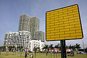 Florida,  Miami,  Midtown,  Art Basel,  Pedestriart,  urban art project,  public art installation,  street signs,  artist,  Loenel Matheu,  yellow bricks,  high rise building,  park