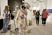 Florida,  Miami,  Midtown,  Art Basel week,  Art Miami,  exhibit,  gallery,  galleries,  collector,  shopping,  modern,  contemporary,  art show,  culture,  Hispanic,  man,  woman,  couple,  sculpture,  nude mannequin,  futuristic,  visitors,  Asian,  Rud