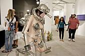 Florida,  Miami,  Midtown,  Art Basel week,  Art Miami,  exhibit,  gallery,  galleries,  collector,  shopping,  modern,  contemporary,  art show,  culture,  Hispanic,  man,  woman,  couple,  sculpture,  nude mannequin,  futuristic,  visitors,  Asian,  Rud