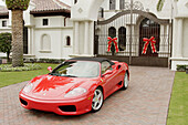 Florida,  Boca Raton,  Royal Palm,  gated community,  upscale,  rich,  upper income,  big,  house,  mansion,  luxury home,  McMansion,  driveway,  landscaping,  real estate,  Christmas decorations,  red,  Ferrari,  sports car,  ostentatious,  gate